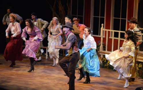 "The entire company of B&B's ""Oklahoma!"" kicks up their heels in a rousing dance number at the social."