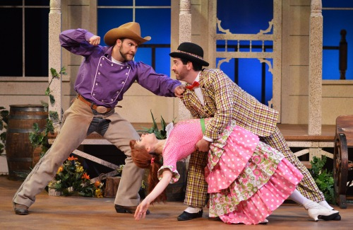 "Daniel S. Hines (Will Parker), Brian Sutow (Ali Hakim), and Timmy Hays (Ado Annie) form the comic love triangle in B&B's ""Oklahoma!"""