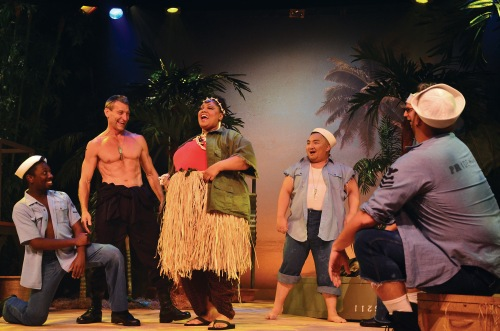 Bloody Mary (Cynthia Thomas), center, laughs with the Seabees in Beef & Boards' production of South Pacific.
